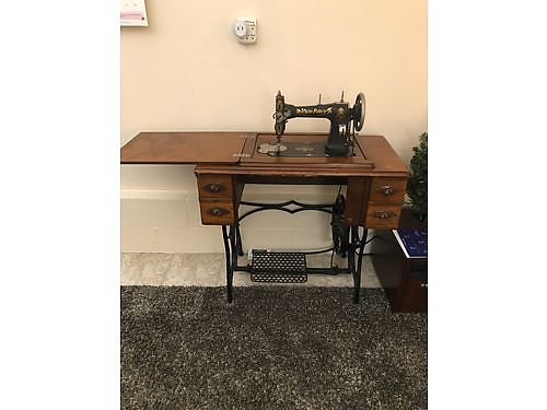 SEWING MACHINE Antique Family Heirloom 100 years old all attachments Cast iron frame  treadl