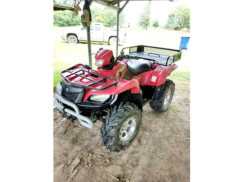2005 SUZUKI KING QUAD 700 174 hrs Mud Lite XTR radials bumpers and winch red in color 3200 I
