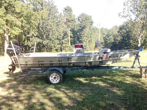 14 JOHN BOAT new Mercury 8 four-stroke motor paid 2200 for motor trolling motor great conditio