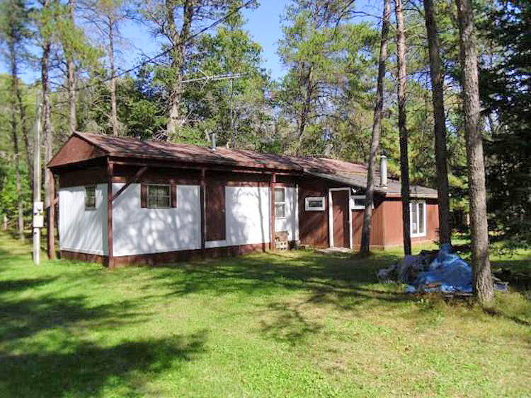 815 ARNOLS Lake Road Frost Township MI 48625 1 block to state landtrails wood stove heat well