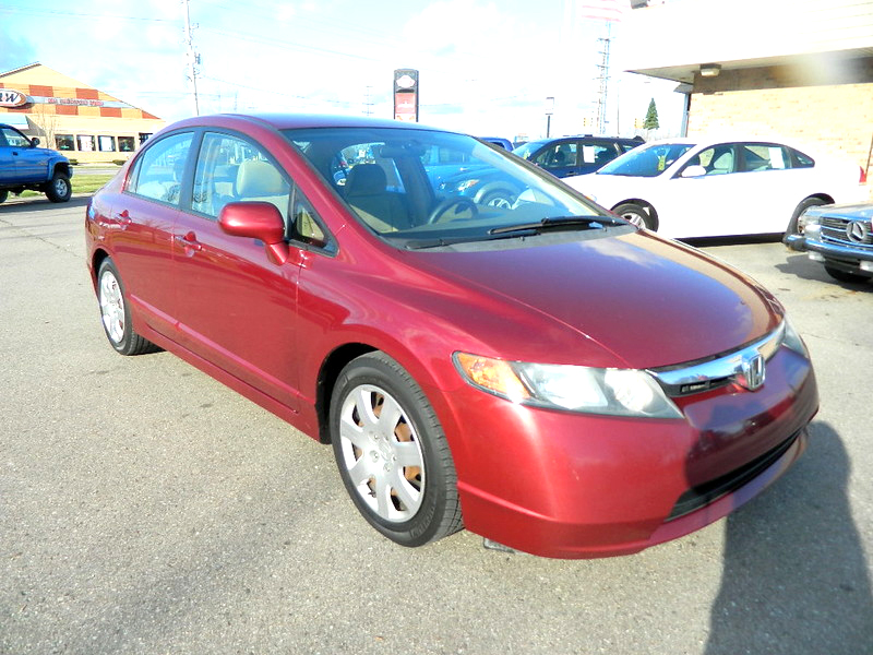 2006 HONDA Civic LX 1670 4 door 131000 miles very clean 40 MPG highway 6800