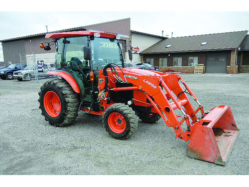 2015 KUBOTA L6060HSTC cab tractor with 2015 LA1055 front loader one owner unit balance of factory