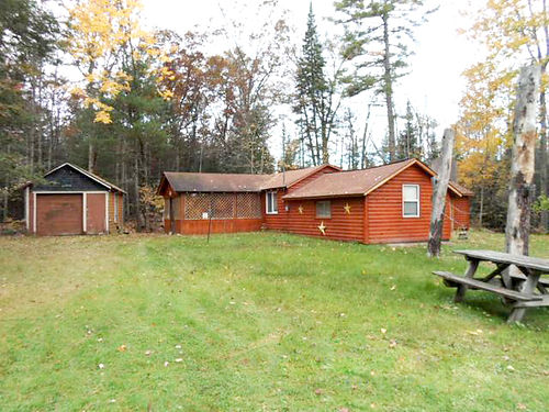 228 ELDER Harrison - 1952 log cabin homestead enclosed porch field stone fireplace 32x40 pole ba