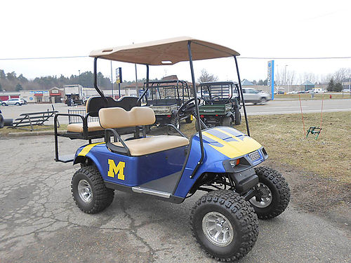 EZ-GO TXT 48 Golf Cart 48 volt electric drivetrain smooth ride greater energy effiency