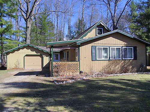 3640 LANSING Roscommon - For Sale 3 bedroom 15 bath 2 car garage wrap around deck close to st