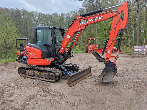 KUBOTA KX057 Excavator OP weight 12820 128 dig depth 197 max reach full cab with heat and a