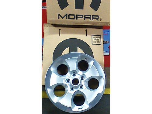 RIMS set of 4 Alloy rims 18 OEM 5 lug off Jeep Wrangler rims only same as new REDUCED to 25